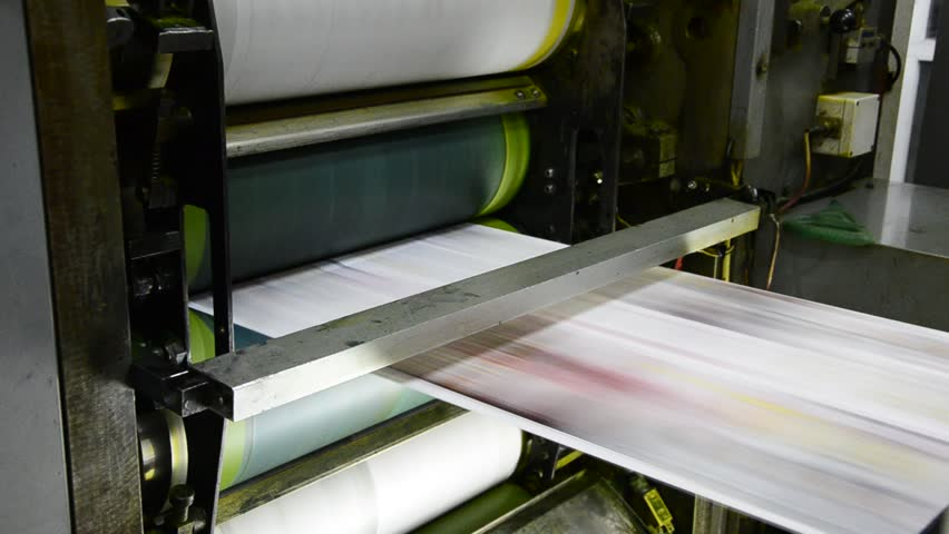 offset print press hit set roll paper goes through the rollers of the printing units