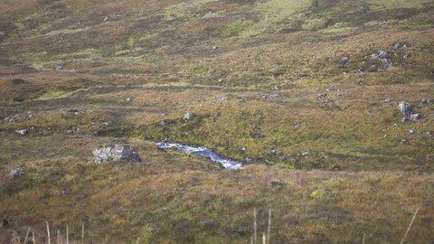 Wind and Clouds in Glen Coe Valleys in Scotland in Autumn