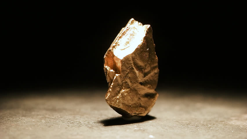 Closeup of a big gold nugget, slow motion footage | Shutterstock HD Video #33865270