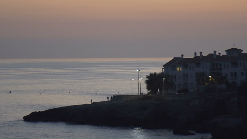 Luxury homes near the coast at sunset