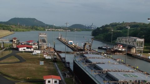 PANAMA CANAL/PANAMA - 9TH APRIL 2011: Mules pull Bulk carrier Atlas Island out of Miraflores Lock on Panama Canal