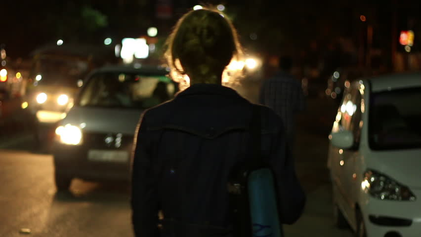 Girl walking in the night on road. Cars going. Cars light.   Shutterstock HD Video #33898699