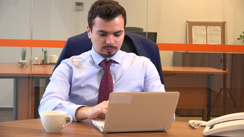 Bad financial news bankruptcy desperate worried casual businessman work laptop | Shutterstock HD Video #33903031