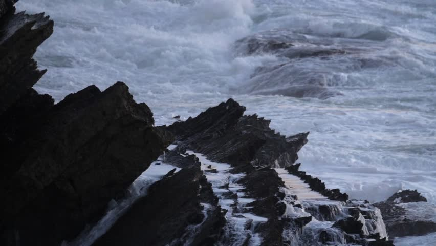 Waves crashing on the Rocks. Pure power, exhibition of nature forces. Pure energy. Ocean power against earth. This is how Erosion occurs .Waves crashing on the Rocks. Pure power, exhibition of nature