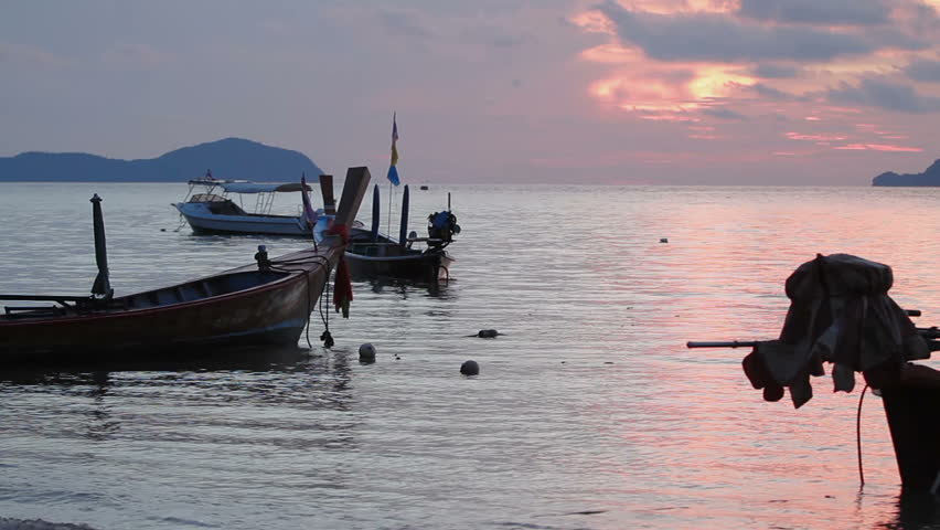 PHUKET, THAILAND - November 20, 2012. Sunrise on Rawai beach. Seascape with fishers boats. Early morning cloudscape. | Shutterstock HD Video #33916258