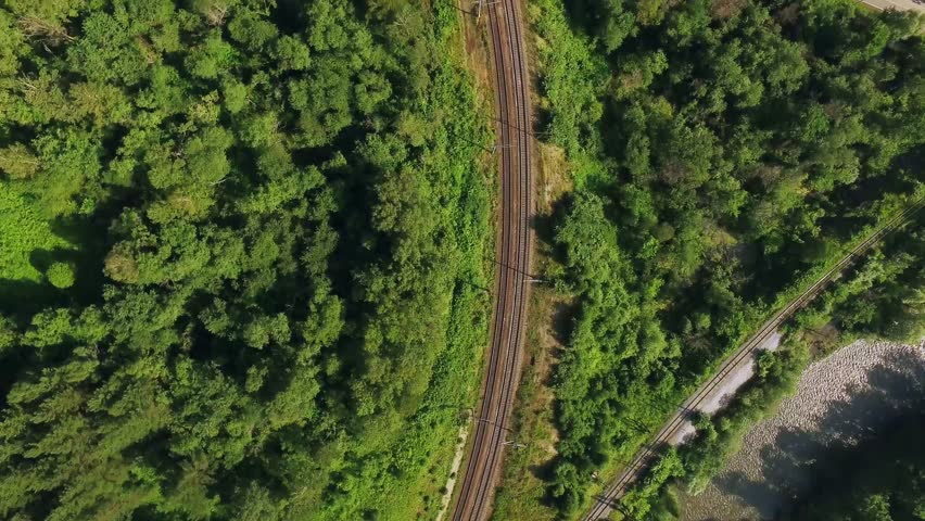 Empty winding railway, endless railway without train  - aerial top view  #33918031