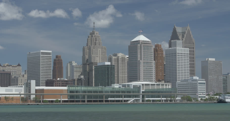 Beautiful sunny day of the downtown skyline and towering buildings in Detroit, Michigan.