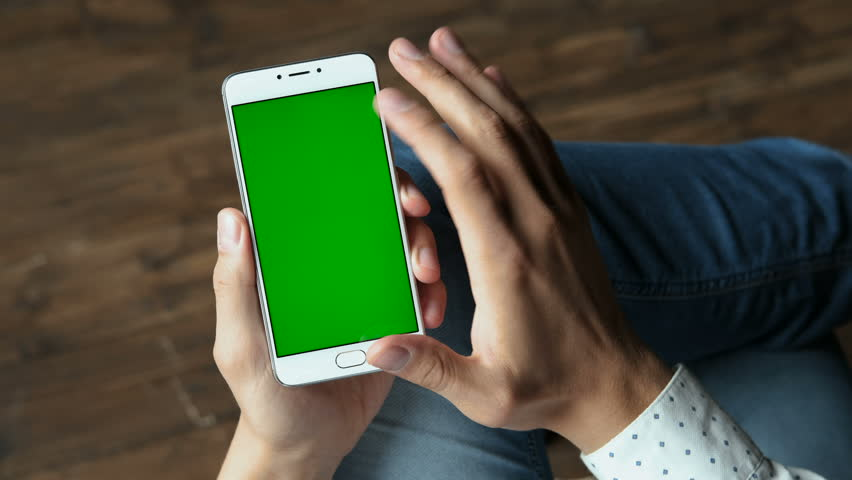 Human arms hold electronics portable device with greenscreen chromakey closeup. Guy gesturing: tapping app by wireless. Joyful time by watching, reading news and looking social media web pages | Shutterstock HD Video #33932539