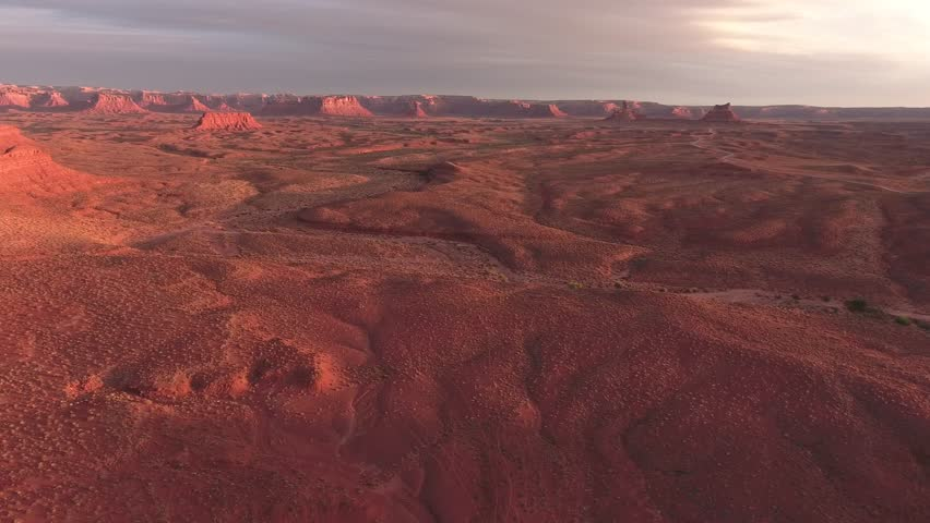 Amazing drone aerial video of the valley of the gods and monument valley at sunrise and sun set magic hour on the border of arizona and utah