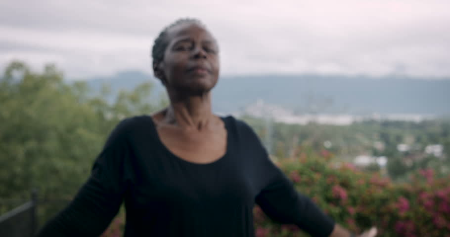 Active baby boomer African American woman in 60s exercising yoga sun salutation poses outdoors with great view Royalty-Free Stock Footage #33958987