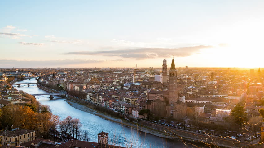 Verona, Italy. Aerial view of famous touristic city Verona in Italy at sunset. Bright sky with illuminated historical buildings. Time-lapse at sunset | Shutterstock HD Video #33975142