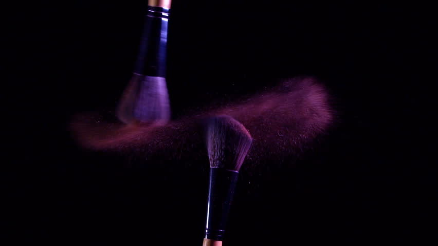 Slow motion of Cosmetic brush with violet color cosmetic powder spreading on black background | Shutterstock HD Video #33991960
