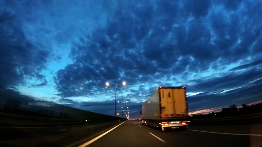 Dash Cam Overtaking Truck at Sunset Blue Sky POV, Poland Europe | Shutterstock HD Video #34014817