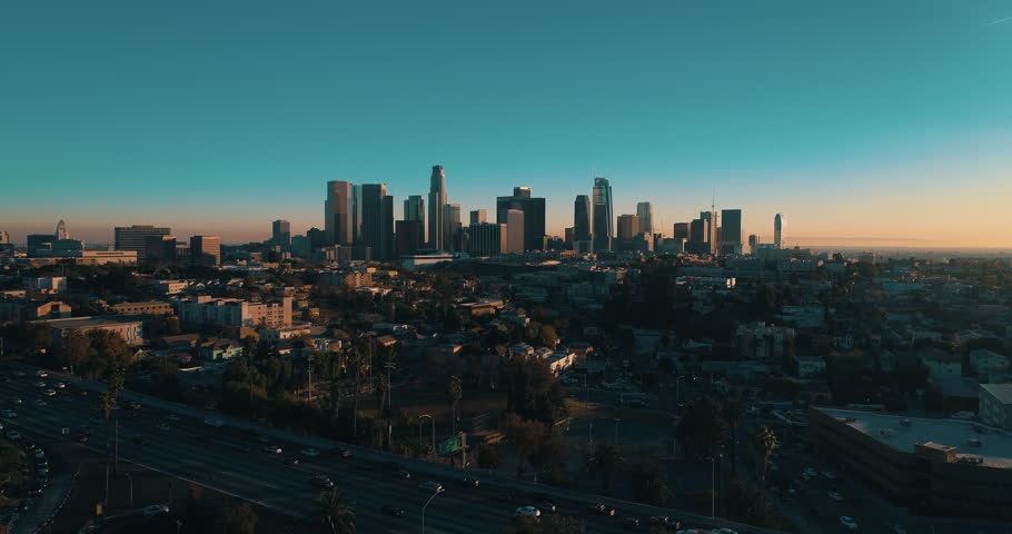 Cinematic aerial drone footage of downtown urban Los Angeles with city skyline, freeway and traffic below. | Shutterstock HD Video #34029892