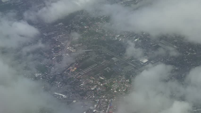 View from an airplane when landing on a cloudy area in the Moscow Region  | Shutterstock HD Video #34035010