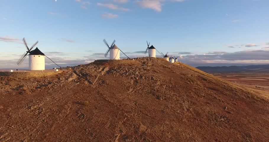 Windmills of Cervantes Don Quixote in Consuegra. Castile La Mancha, Spain, Europe - Aerial Wide Angle view from the top at sunset