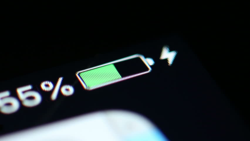 Time Lapse: A Smartphone Battery Is Charged From Zero to 100%. Close up macro shot of the battery level indicator on a smart phone being charged in time lapse.
