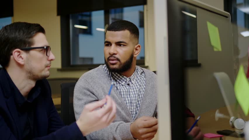 Two creative guys discussing business ideas  | Shutterstock HD Video #34056892
