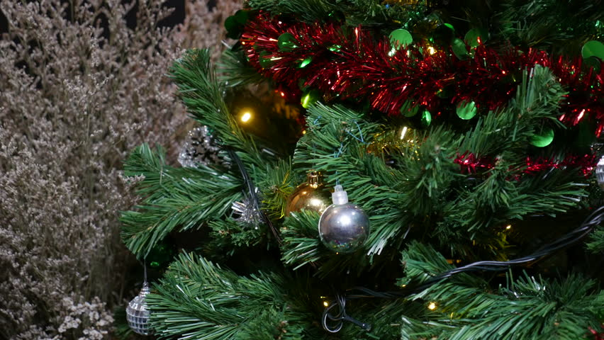 Ornaments on a christmas tree decorated with light. | Shutterstock HD Video #34062040