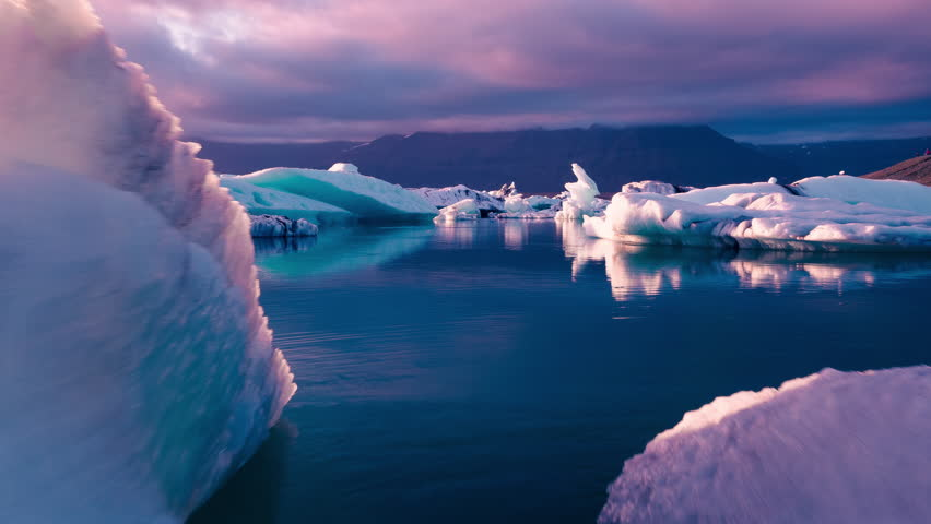 Aerial Drone Flight Over Iceberg Pieces Melting In A Beautiful Ice Lake Majestic Sunset Climate Change Extreme Adventure Concept