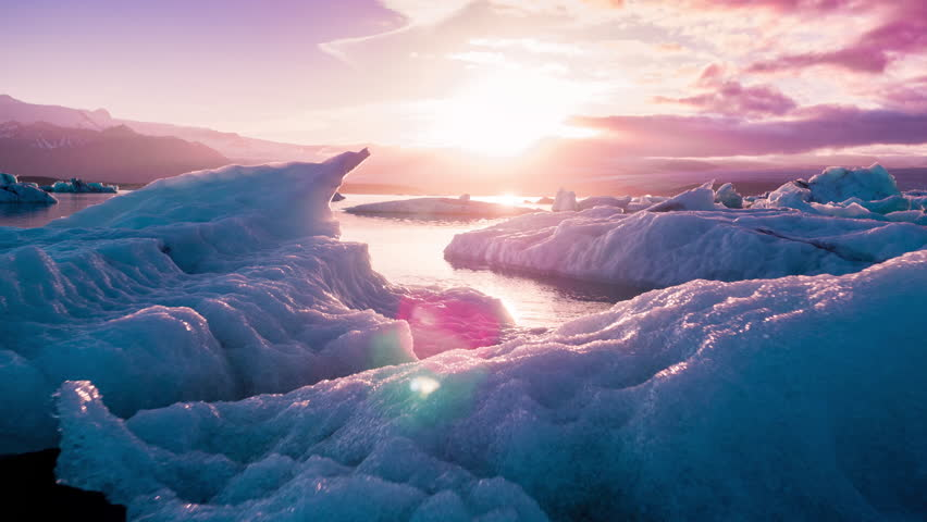 Aerial Drone Flight Over Glaciers Particles Floating In Glacial Lake Sunset Colors Ice Caps Iceland Exploration