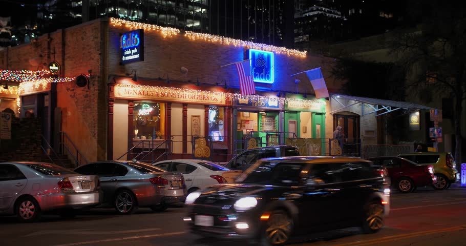 AUSTIN - Circa December, 2017 - A nighttime establishing shot of bars and restaurants on W 4th Street in downtown Austin. Day night matching available.