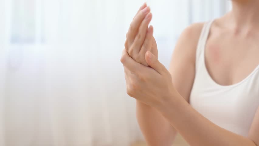 Beautiful model applying cosmetic cream treatment on her hand on bedroom background.   Shutterstock HD Video #34068811