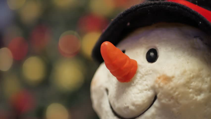 Christmas snowman decoration closeup. Soft focus of snowman,christmas tree background. | Shutterstock HD Video #34073695