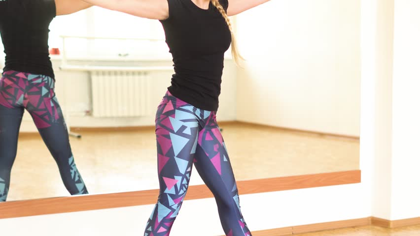 Girl doing yoga in the hall   Shutterstock HD Video #34077604