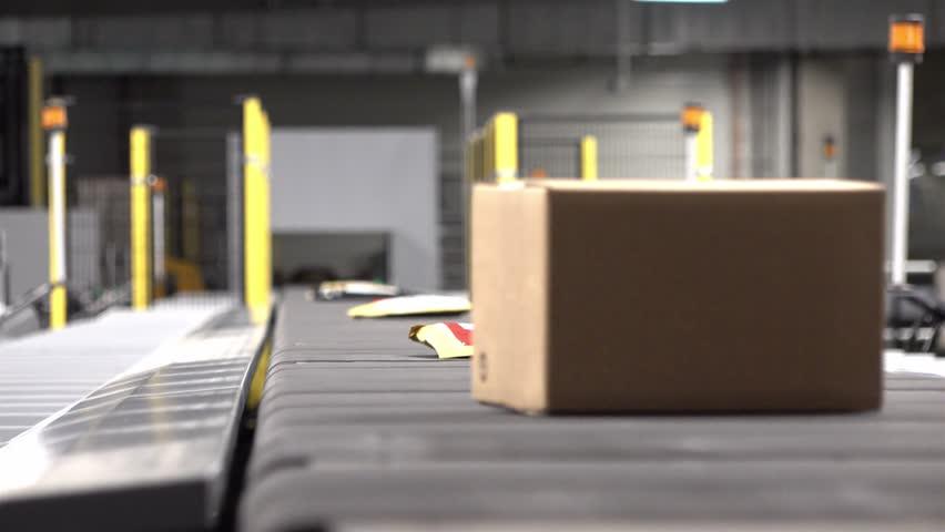 Huge amount of parcels bein transported on conveyor belt system | Shutterstock HD Video #34109455