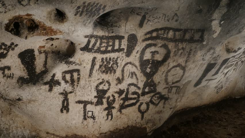 RABISHA, BULGARIA - OCTOBER 16, 2017: Motifs of everyday life on Magura cave walls older than 7000 years slow pan footage | Shutterstock HD Video #34109554