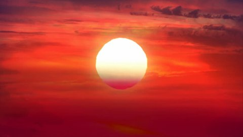 Big, large, huge, giant sun close up zoom time lapse. Orange, golden, red sky sunset sun clouds timelapse. Big sun closeup declining, going down, moving motion. Yellow, gold sun time lapse