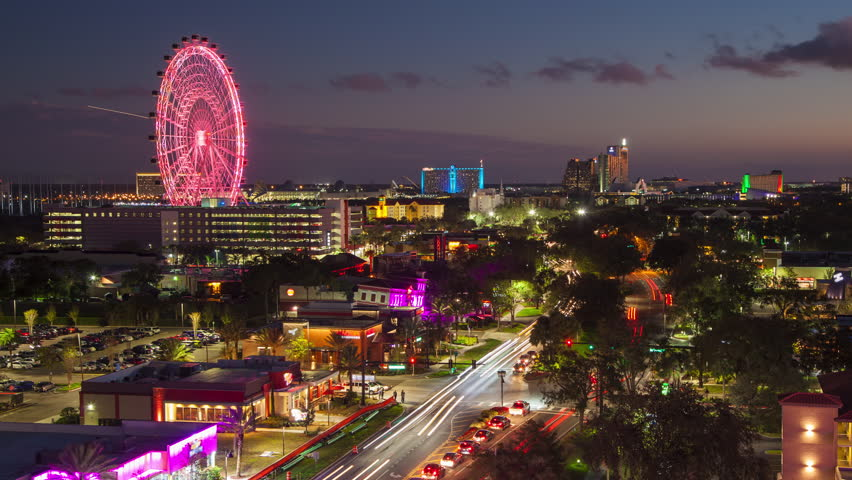 Orlando FL International Drive Timelapse at Night with Colorful Big Wheel Attraction and Cars Driving along the Popular Stretch of Road lined with Restaurants Hotels and Attractions | Shutterstock HD Video #34124896