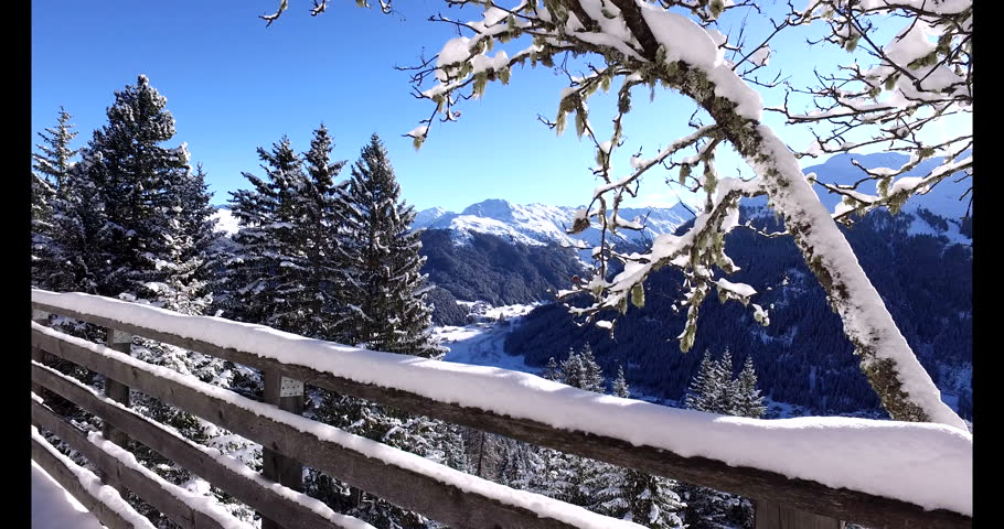 Travelling of the city of DAVOS, SWITZERLAND. Sunrise aerial panorama in sunny winter day. Famous ski resort in swiss alps and home of ecomic forum