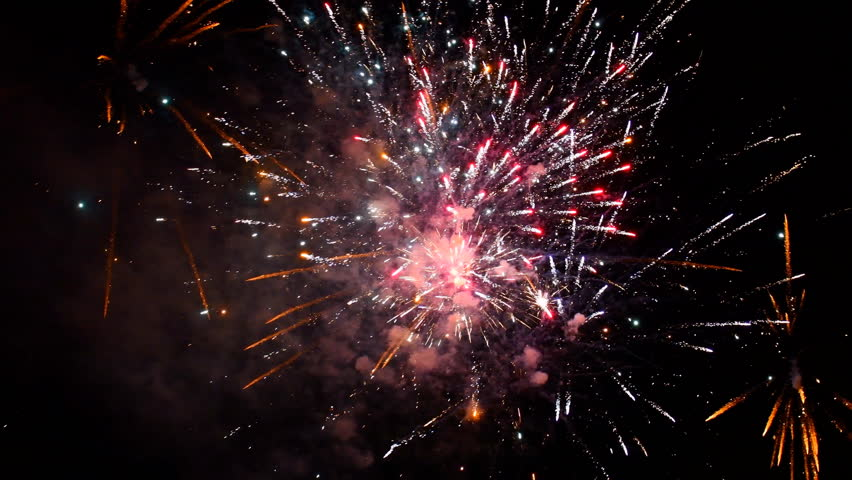 Fireworks exploding in various colors in the dark night sky during a celebration. | Shutterstock HD Video #34130770
