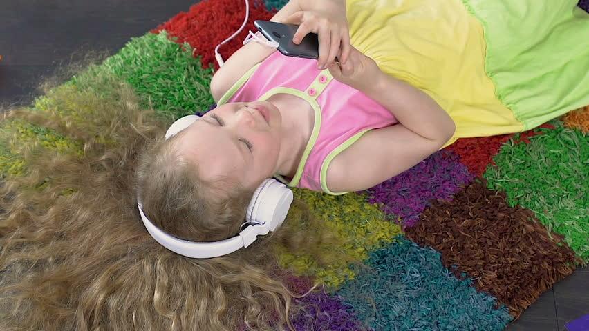 Lovely little girl video calling her parents on phone, modernized communication | Shutterstock HD Video #34155685