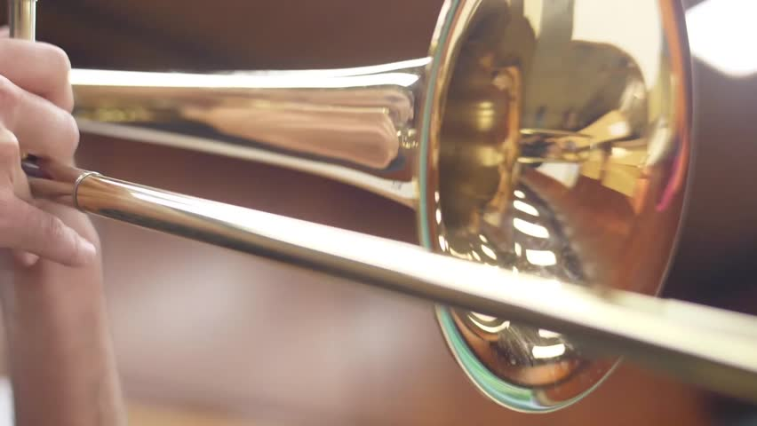 Trombone from orchestra musician in case slow motion