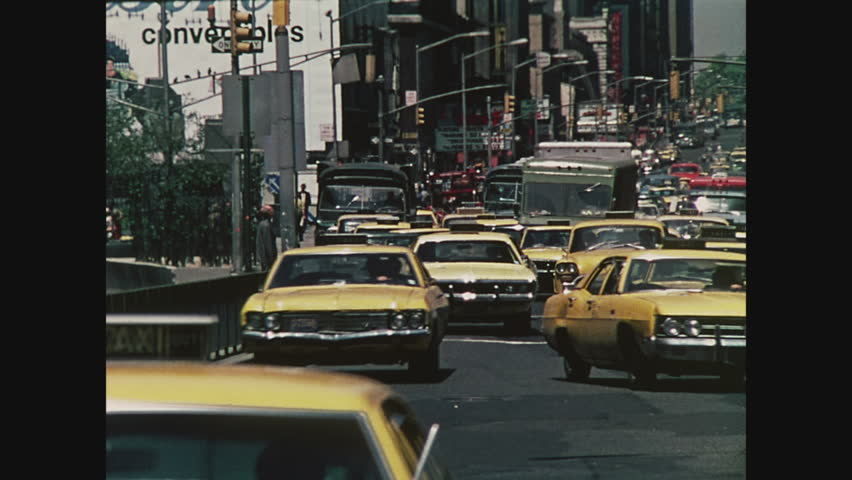 NEW YORK, 1971, Yellow taxis on Seventh Avenue in Times Square