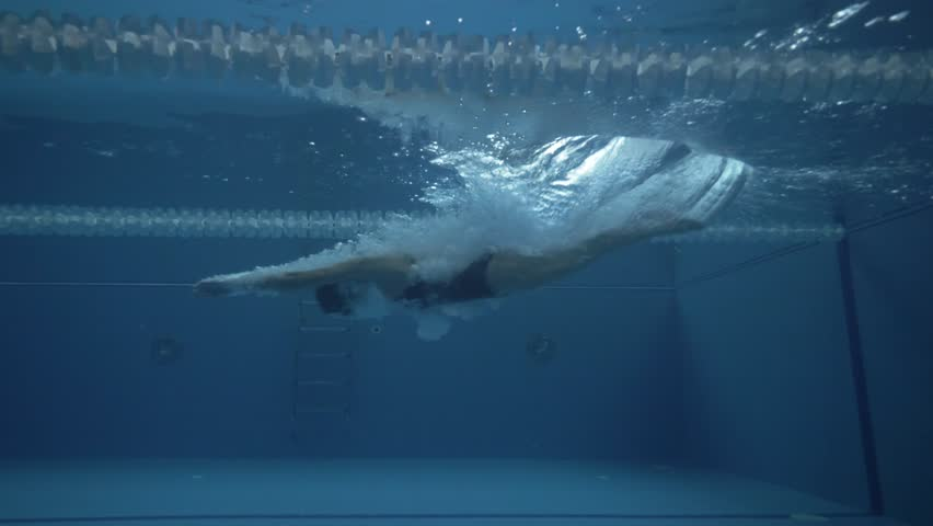 Woman swimmer dive in water pool at start. Swimmer jump at deep water pool #34180096