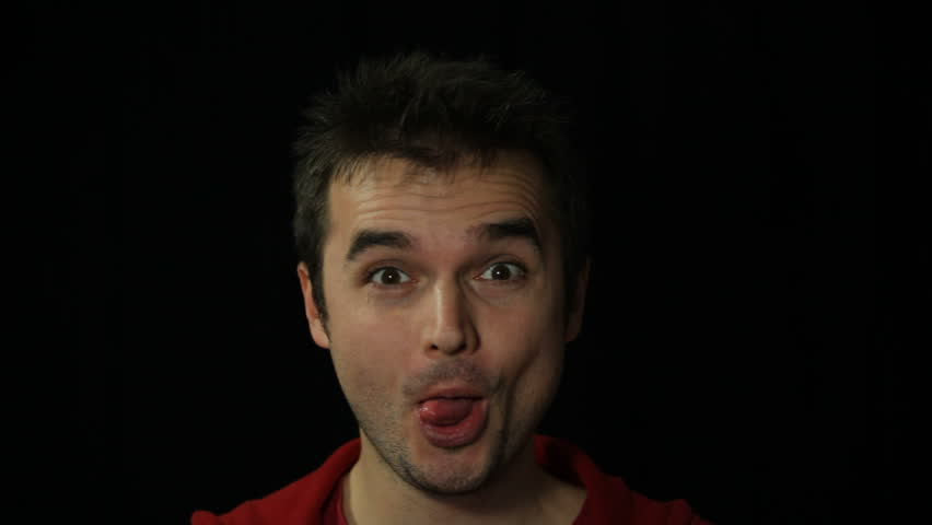 Man making funny faces, studio isolated | Shutterstock HD Video #3418664