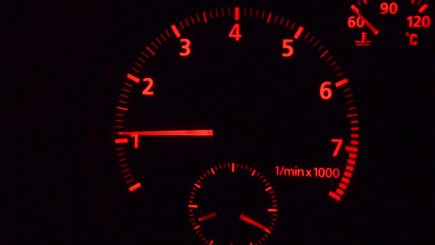 Car tachometer and moving pointer on it indicating the varying engine RPM. HD.