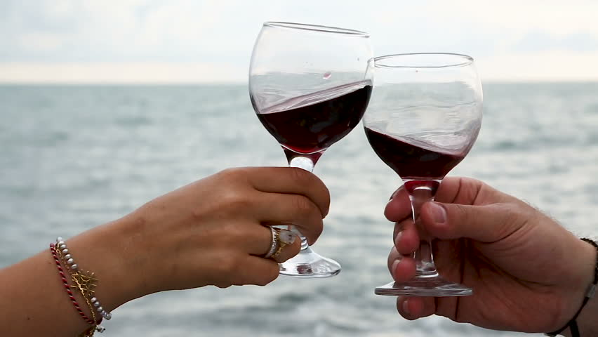 Couple drinking red wine at the seaside, romantic date, spending time together | Shutterstock HD Video #34215313