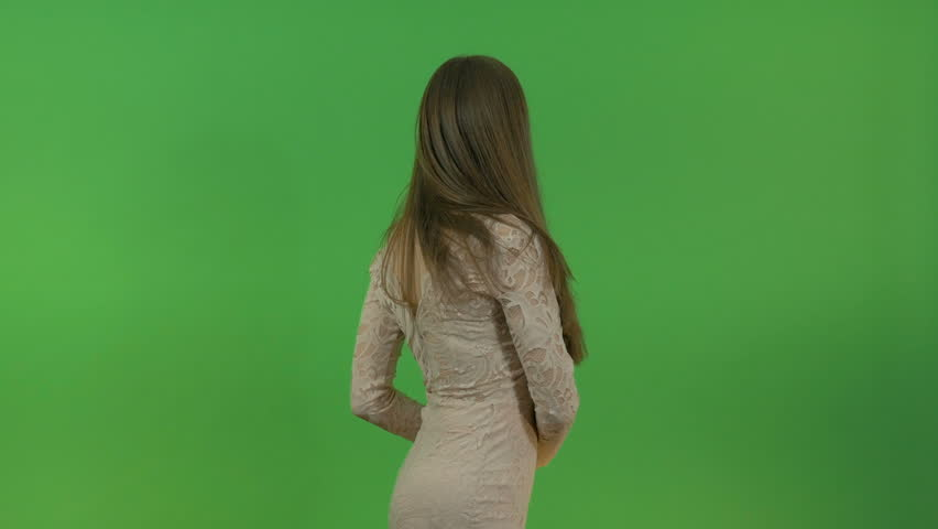 Young beautiful girl with long hair asks a question and points to three objects behind her back. On the green screen. | Shutterstock HD Video #34230571