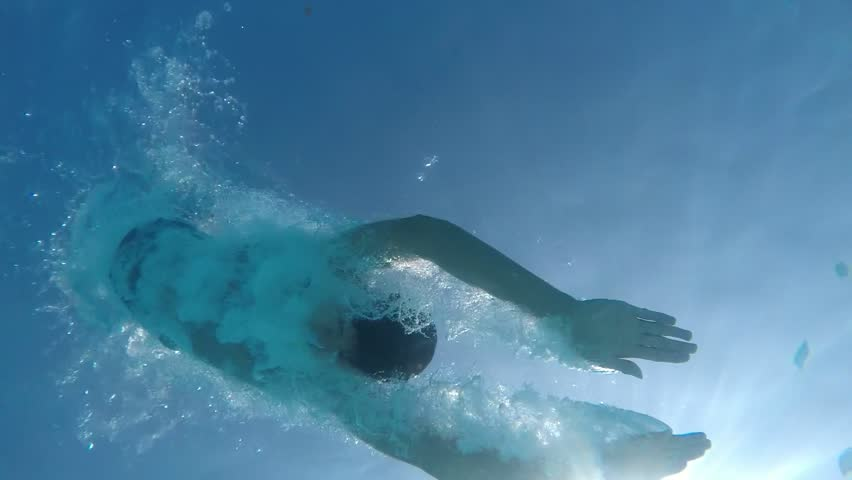 A stunning view of a young man doing a swallow dive on a Turkish resort in the Mediterranean sea. He is shot from underwater in slow motion. Royalty-Free Stock Footage #34232221