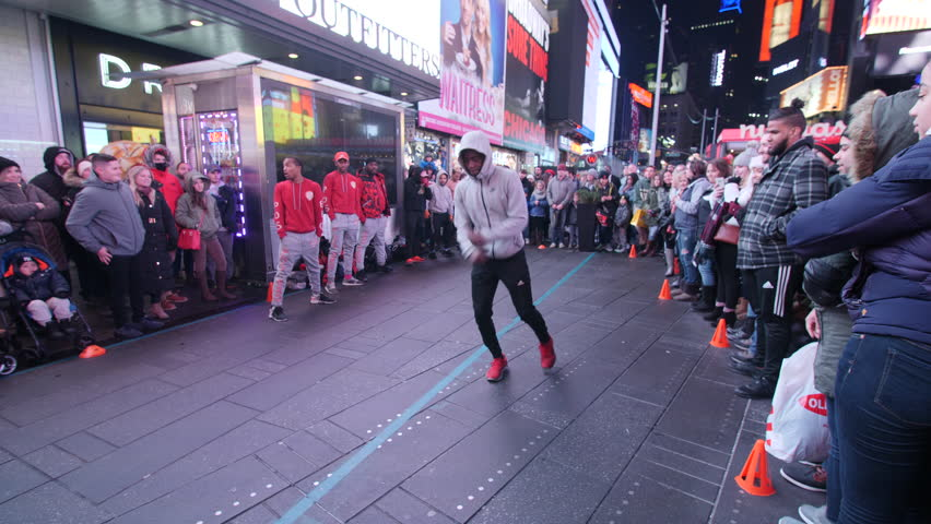 NEW YORK, Times square street performer with crowd during Christmas weekend, New York, New York. 4K footage, 3-Axis Handheld Gimbal Stabilizer