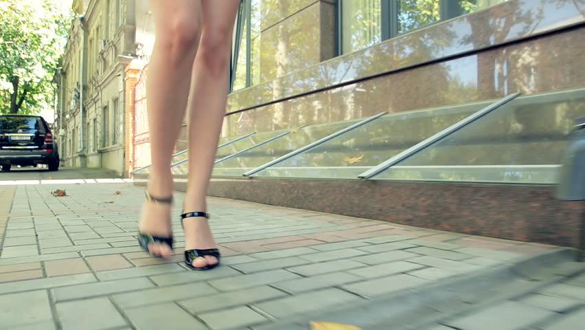 Business woman walks through autumn quarter. View on legs #34269514