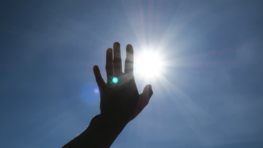 Hand of man strive to sun and deep blue sky. Conceptual scene. | Shutterstock HD Video #34269826
