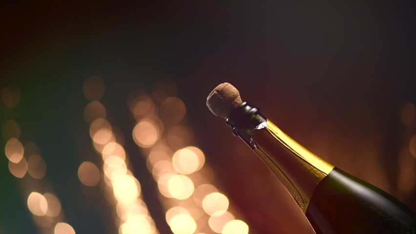 Champagne explosion. Champagne popping, opening champagne bottle closeup. Sparkling Wine over Holiday Bokeh Blinking Background. Party, Success, holiday celebrating. Slow motion UHD 4K #34277425