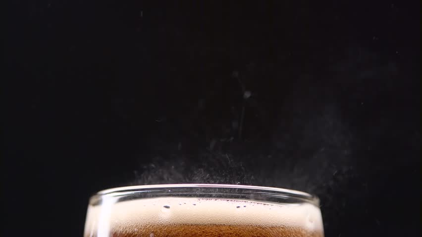 Fizzy cola in a glass spray gases on a black background. Close up | Shutterstock HD Video #34288153