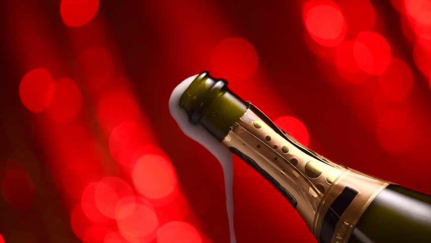 Champagne explosion, popping over red blinking background, opening champagne bottle closeup. Sparkling Wine Background. Champagne bottle closeup. Success, holiday, wedding celebrating. Slowmo. UHD 4K #34294912